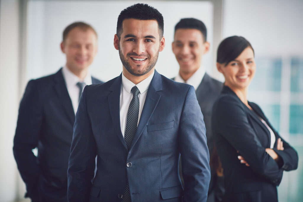 confident business team with leader